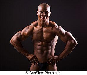 african bodybuilder on black background
