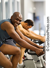 african man working out - fit african man working out in gym