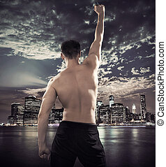 Fit athlete over the city background