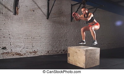 Fit Athletic Woman Does Box Jumps in the Deserted Factory...