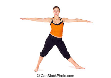 Fit attractive young woman doing first stage of yoga pose Warrior 2, isolated on white background