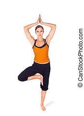 Fit Attractive Woman Practicing Yoga Tree Pose - Fit...
