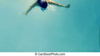 Fit brunette diving into swimming p