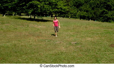 Fit brunette sprinting towards the camera