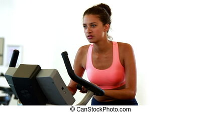 Fit brunette working out on the exe