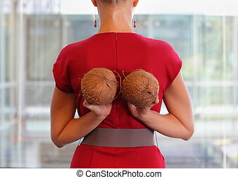 woman with two coconuts