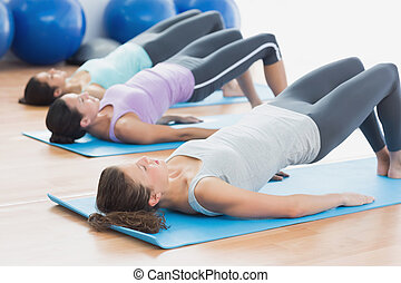 Fit class exercising at fitness studio - Side view of fit ...