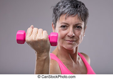 Fit determined woman working out with weights