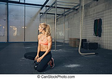 Fit female athlete at crossfit gym