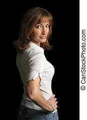 Fit & Flirty - A beautiful, mature woman against a black ...