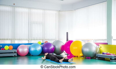 Fit Girl Finishing Yoga Class On Exercise Mat