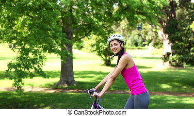 Fit girl going for a bike ride in the park