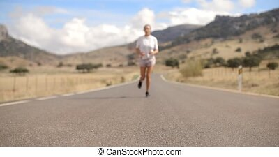 Fit Girl Running on Mountain Road in Spanish Andalucia, Slow...