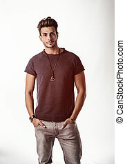 Fit handsome young man standing confident in casual clothes