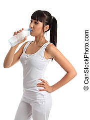 Fit healthy girl drinking water