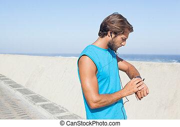 Fit man jogging on promenade