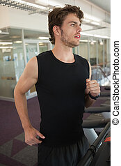 Fit man jogging on the treadmill
