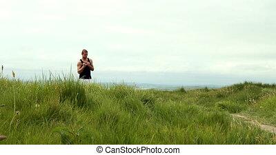 Fit man jogging through sand dunes