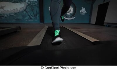 Fit man legs running on treadmill
