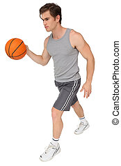 Fit man playing basketball