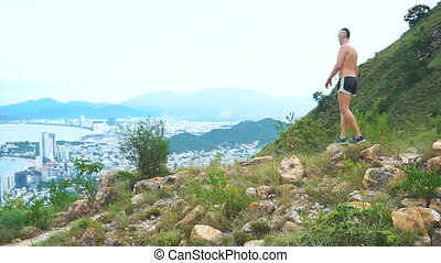 Fit man runner happy and celebrating success. Male stand on...