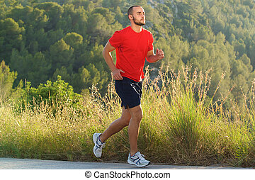 Fit man running outdoors