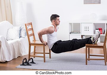 Fit man stretching at home