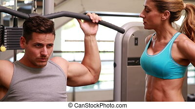 Fit man using the weight machine