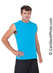 Fit man with hand on hip