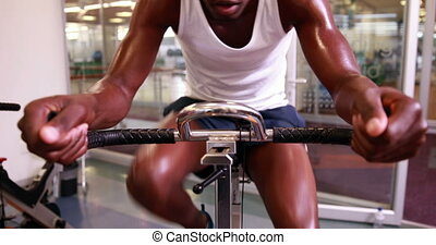 Fit man working out on the exercise