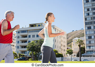 Fit mature couple jogging together
