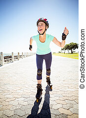 Fit mature woman rollerblading on the pier