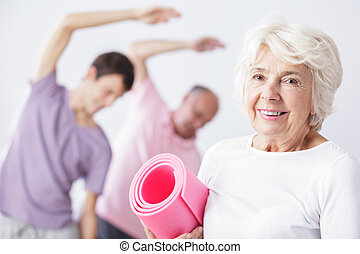 Fit means happy and healthy - Happy senior woman holding...