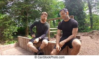 Fit men relaxing over obstacle course 4k - Fit men relaxing ...