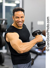 mid age man training with dumbbell - fit mid age man...