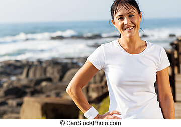fit middle aged woman portrait at beach in the morning