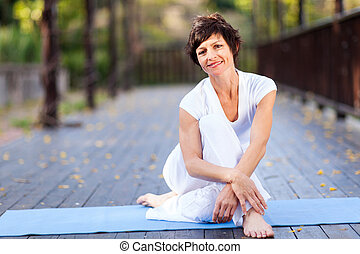 fit middle aged woman relaxing