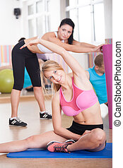 Fit people stretching
