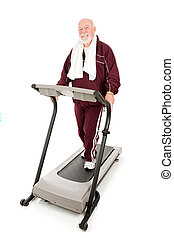 Handsome, fit senior man exercising on a treadmill. Full body isolated.