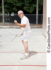 Fit Senior Man Playing Racquetball