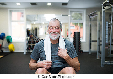 Fit senior man resting after working out. - Fit senior man...
