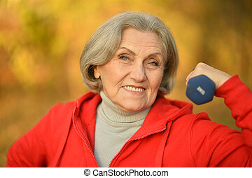 fit Senior woman exercising
