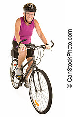 Isolated on white, a fit senior woman is riding a bicycle.