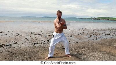 Fit shirtless man practicing