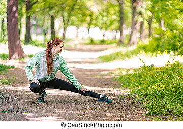Fit sportive women stretching in the park. Healthy life and...