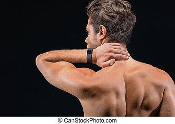 Fit sportsman suffers from neckache