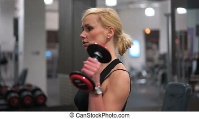 Fit strong young blond woman