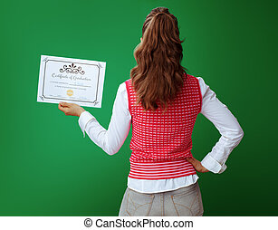 fit student with Certificate of Graduation isolated on green