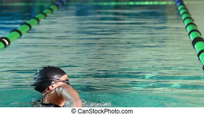 Fit swimmer doing the front stroke