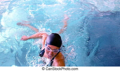 Fit swimmer jumping up and cheering in the pool in slow...
